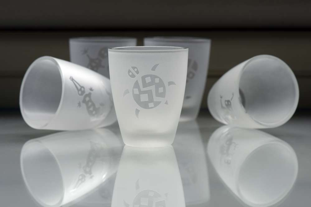 A laser decorated glass with opaque finishing