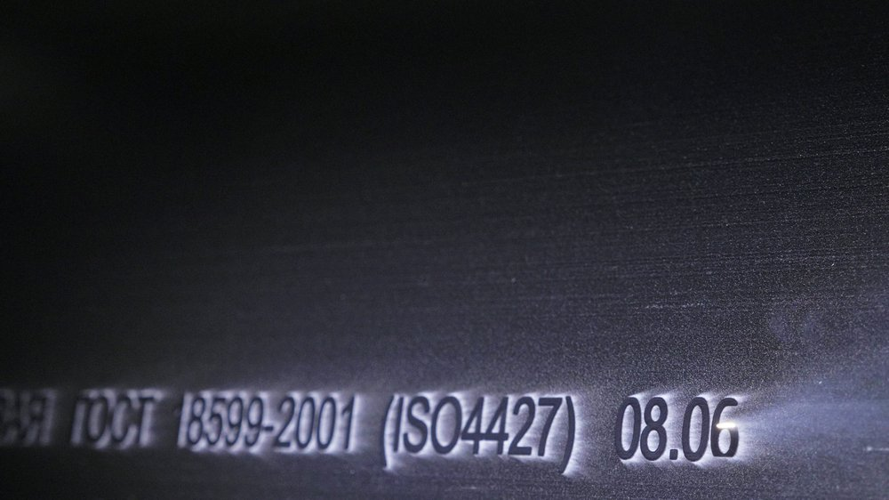 Laser creating identification numbers